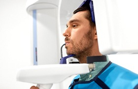 A CBCT scanner being using on a male patient