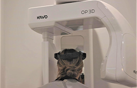 Dentist and patient looking at intraoral images on computer screen