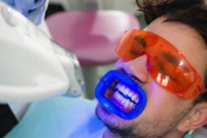 man receiving teeth whitening