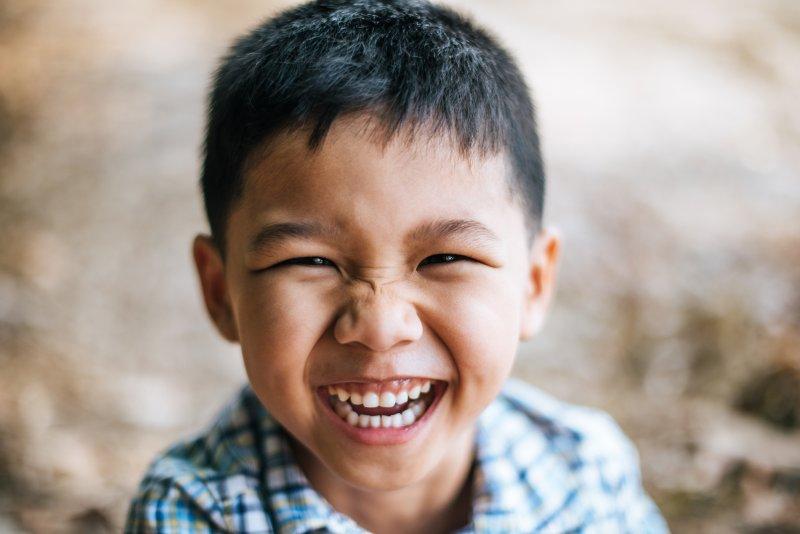 closeup of little boy smiling